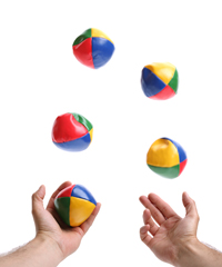Two hands juggling balls