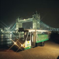 A milk float next to Tower Bridge in London.