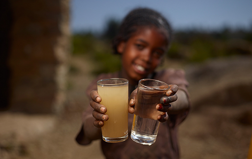 Child with glasses of water