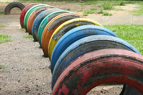 A tunnel made of tyres, in a children's playground