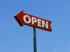 Red arrow sign with white letters which say 'open'