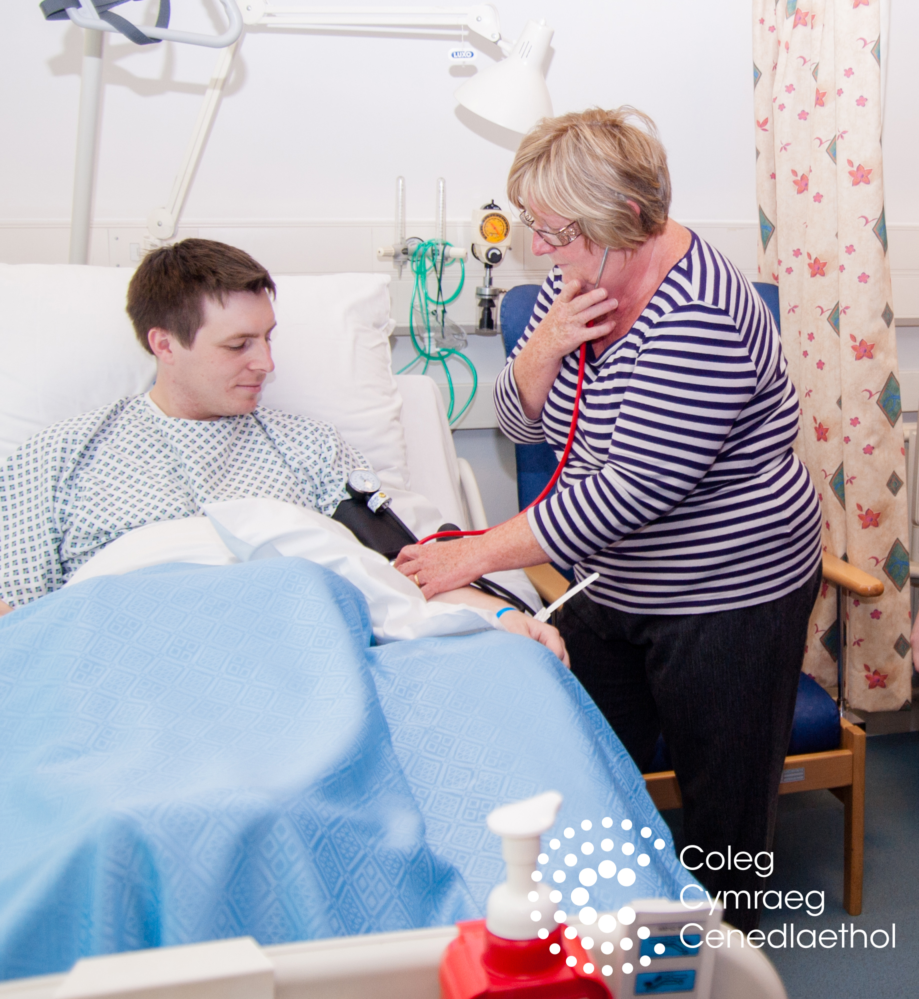 Doctor taking blood pressure of patient in bed