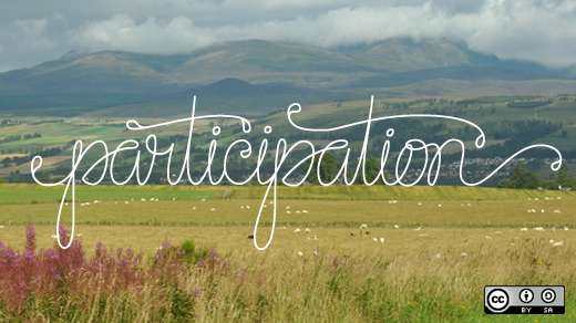 the word participation in white lettering on a view of a landscape