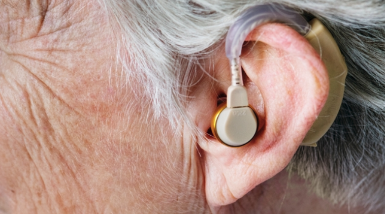 Elder With Hearing Aid