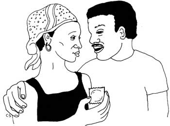 A woman talking with her partner and holding a condom.