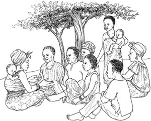 A group of people sitting beneath a tree discussing healthy eating with a pregnant woman who has a baby wrapped on her back. One woman is standing holding a baby.