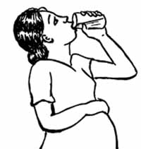 A pregnant woman drinking a glass of water