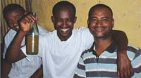 Three men drinking alcohol together.