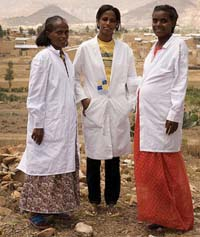 A team of three health workers standing together.
