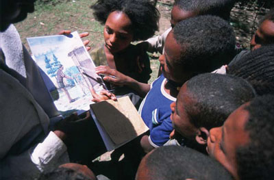 Children with hygiene education cards
