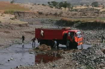 Washing a lorry in the river