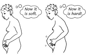 A naked woman having contractions.