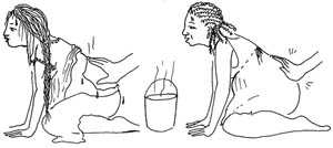 A woman in labour has a warm wet cloth applied to her back to ease the pain whilst another has a gentle massage on the lower back.