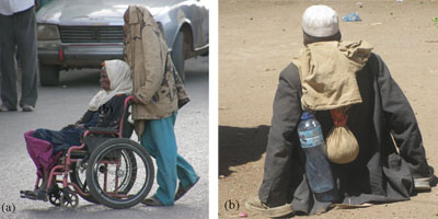Man and woman with a physical impairment, however the woman has a wheelchair