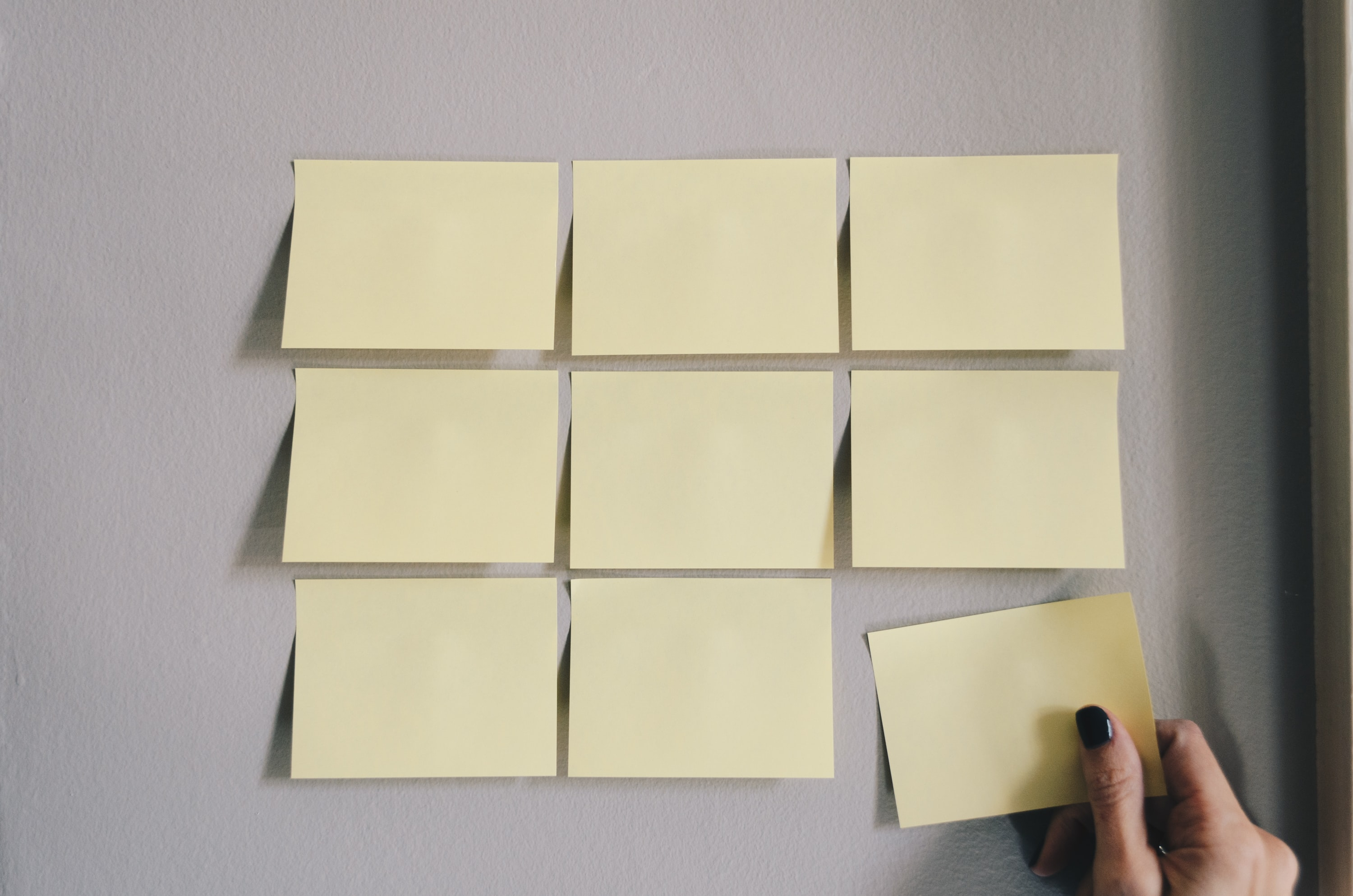 Blank post-it notes on a wall