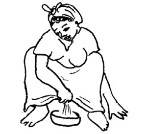 A woman squats over a bowl to urinate.