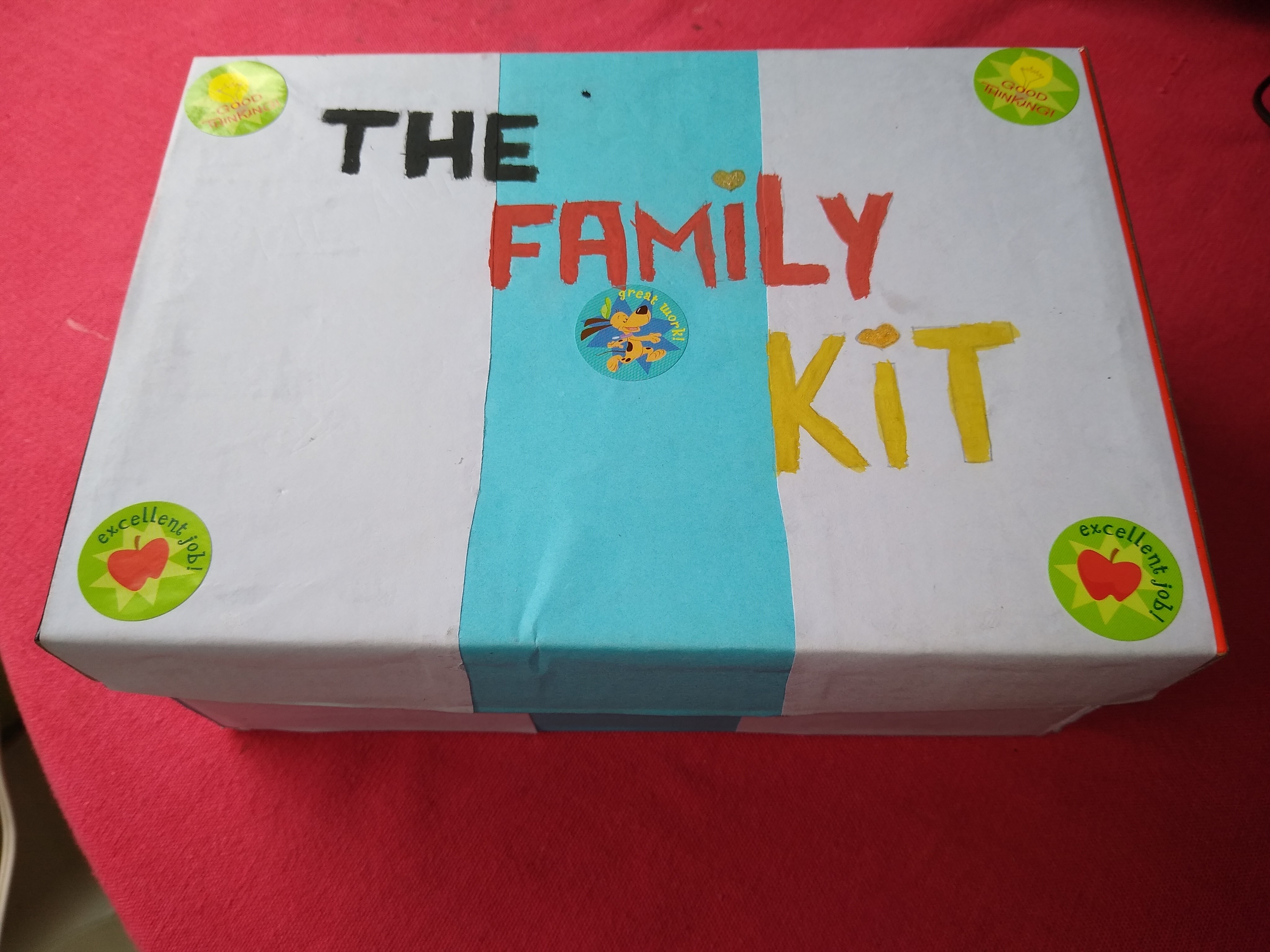 """Box with """"The family kit"""" written on it"""