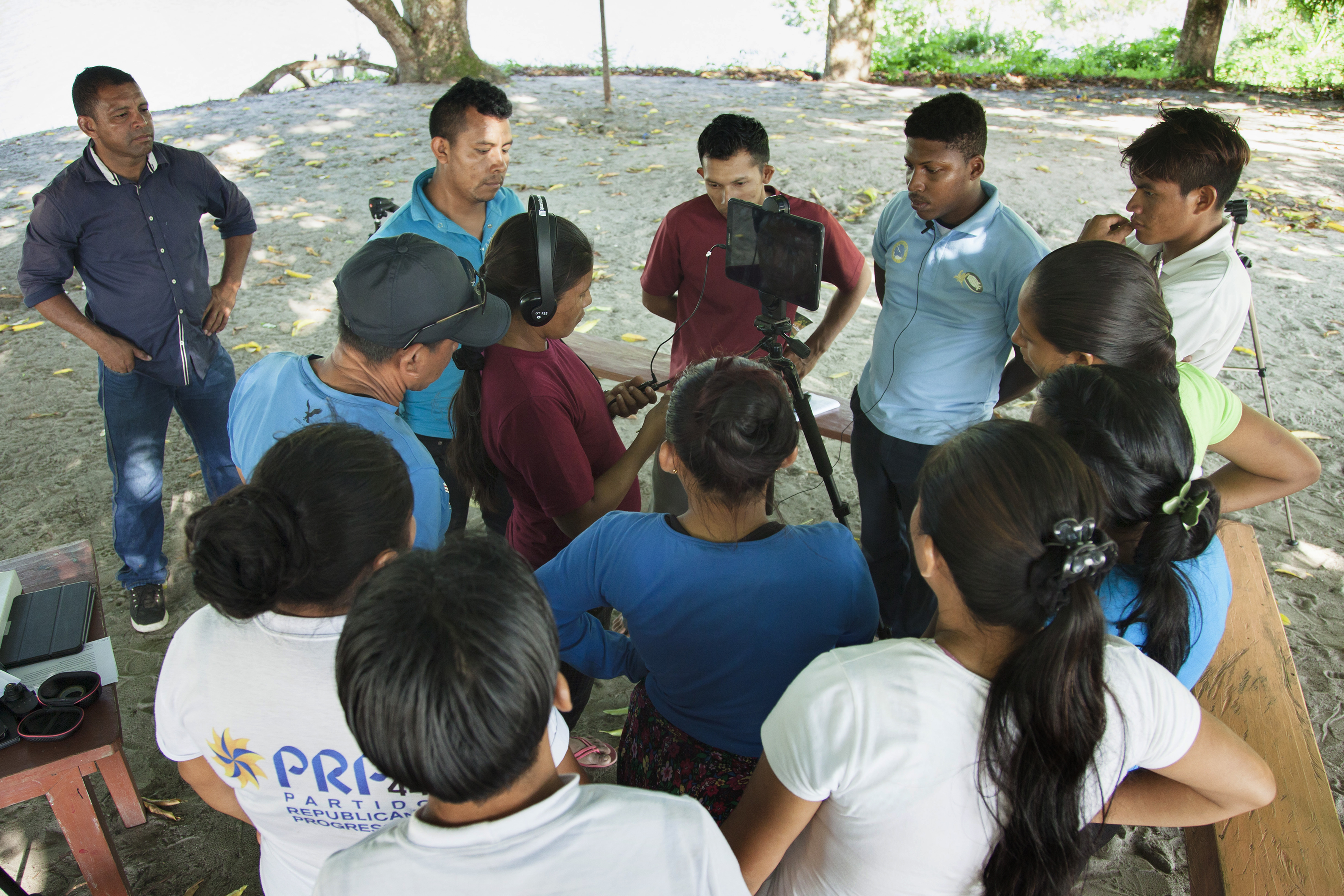 A group of Guayanese people doing a participatory video session