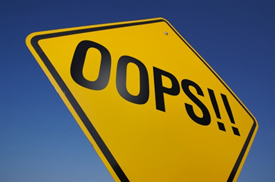 """Yellow road sign saying """"OOPS!"""""""