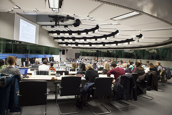 Photo of a meeting of people with senior officials in a conference room in Brussels